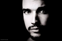 Quiet Eyes (khanusiak) Tags: shadow blackandwhite bw man male monochrome face dark goatee shadows darkness handsome lowkey hanusiak