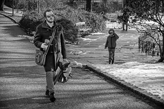 """Walking the dog"" (Terje Helberg Photography) Tags: park street city winter people urban blackandwhite bw monochrome sunglasses norway town candid citylife streetphotography samsung bergen bnw toydog nygårdsparken greyscale visitnorway ilovenorway nx30 visitbergen"