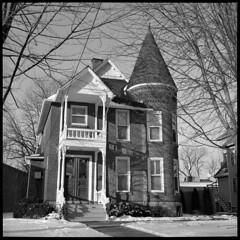 West Liberty (Voxphoto) Tags: winter bw house brick tower architecture minolta trix annarbor 400tx porch 1891 autocord 408wliberty albertmannhouse