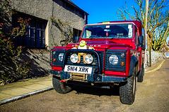 Shrek The Defender (Brian Travelling) Tags: red black green car shrek jeep 4x4 pentax headlights landrover headlamps defender motorcar buiibars