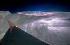 Thunderstorm in the gulf of Mexico (xtremepsionic) Tags: gulfofmexico night plane aircraft thunderstorm lightning fromtheair