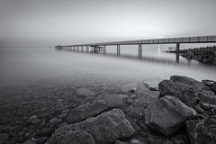 Lake constance B & W (pixadeleon) Tags: longexposure blackandwhite lake water monochrome stones jetty bodensee altnau challengegamewinner