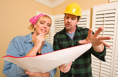 Contractor in Hard Hat Discussing Plans with Woman (nicolekline2221) Tags: blue hardhat woman house man male home hat smiling lady female pencil project paper print real idea construction looking estate realestate room helmet working hard plan blueprint worker plans talking changes contractor understanding improvement schematic asking explaining discussing