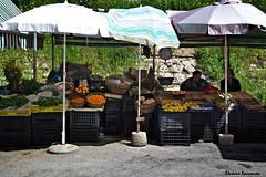 Corfu (Eleanna Kounoupa) Tags: street vegetables fruit umbrella greece corfu publicmarket kumquat ionianislands   historicalcenter    hccity
