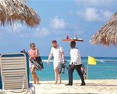A Documentary in Progress with a Fruit Drink (smilla4) Tags: blue sky people beach clouds photographer candid documentary gear resort shore jamaica caribbean ochorios fruitdrink thejamaicainn