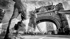 Walk Towards Tower Bridge (Wet Plate) by Simon & His Camera (Simon & His Camera) Tags: road city bridge people urban blackandwhite bw abstract london tower monochrome car architecture arch distorted outdoor wetplate iconic simonandhiscamera
