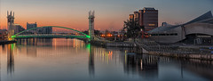 Salford Sunrise (Pete Rowbottom, Wigan, UK) Tags: city uk morning bridge urban panorama reflection water modern sunrise river landscape manchester dawn still interesting architechture glow cityscape earlymorning warmth salfordquays calm symmetry lancashire docklands serene bluehour colourful popular hue lowry urbanlandscape regeneration waterreflections imperialwarmuseum cityofmanchester greatermanchester northwestengland mediacity northwestuk cityofsalford peterowbottom nikond750
