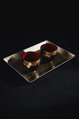 sake-cups1 (miyukim26) Tags: red stilllife japanese gold melbourne plastic cups sake tray cherryblossoms oriental props foodphotography productphotography blackonblack stilllifephotography alienskin foodstyling foodphotographer nikond600 exposure7 miyukimardon magmod maggrid magsphere