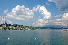 Lucerne 08 (mpetr1960) Tags: blue sky mountain lake building water architecture clouds landscape switzerland boat nikon europe waterfront eu swans lucerne d800 nikond800