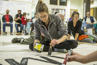 Laura Matter Paints a Banner for a Protest