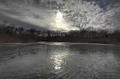 The Breakthrough (KC Mike D.) Tags: winter cloud sun lake tree ice water frozen pond cloudy ripple horizon wave breakthrough partly