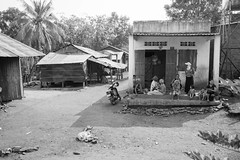 hang out in the shade (kuuan) Tags: houses bw women cambodians village farmers vietnam villagers