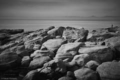 Alone (Paterdimakis) Tags: ocean blue light sea sky bw cloud white seascape black art beach water rock coast blackwhite fishing surf fine greece shore shade rod shape casting blackwhitephotos