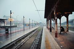 Waiting in Bergamo (Saramanzinali) Tags: street city italy rain station train strada italia centre centro bergamo pioggia stazione treno italie sera citt treni