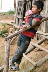 Boy and balloon (Laura Jacobsen) Tags: laos hilltribe akha phongsaly phongsali akhanoukouy
