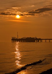 watery sunset (sussexscorpio) Tags: ocean light sunset sea sky orange sun colour beach water silhouette architecture clouds canon landscape gold sussex golden coast pier seaside brighton waves glow ride outdoor pebbles trail reflect coastal shore serene seafront seashore eastsussex goldenhour brightonpier palacepier brightonandhove canon60d thebooster