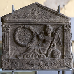 Roman legionary distance slab with reclining Victory, from Old Kilpatrick (diffendale) Tags: facade nude scotland globe sandstone unitedkingdom glasgow goddess victoria victory palm nike architectural frond relief wreath latin corinthian latina reclining boar recumbent legion inscription legionary dea arenaria rilievo iscrizione antoninuspius hunterianmuseum oldkilpatrick antoninewall engagedcolumn 140sce semidraped 2ndcce thehunterian mid2ndcce 150sce 3rdquarter2ndcce distanceslab 2ndquarter2ndcce pleiades:findspot=89259