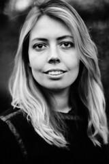 Sanna. (Pim Geerts) Tags: portrait woman monochrome female zeiss canon t corporate eos prime zwartwit bokeh carl mm portret zwart wit vrouw planar 1450 5dm2