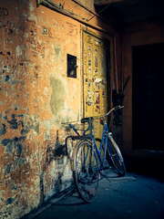 i want to ride my bicycle! (realnasty) Tags: street old city light shadow urban bike bicycle wall contrast hall colorful neglected poland olympus dirty ugly omd lodz shabby m43 mft microfourthirds tanement