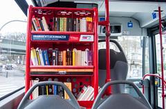 Books on the HVV bus (xxcheng) Tags: red bus germany deutschland europe hamburg books bookshelf transportation vehicle hvv