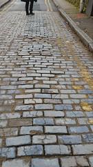Cobblestones in Stepney Green E1 (Carol B London) Tags: road tarmac pavement stones roadworks digging replacement cobblestones cobbles e1 stepney londone1 dugup towerhamlets stepneygreen blueroad eyesores lbth cobblestoned diggingup btopenreach