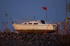 Boat on the rocks.... (CB-Photos) Tags: blue light red sky water boot boat rocks ship stones sony leipzig 300mm blau felsen christmaslight a58 zwenkau gestrandet