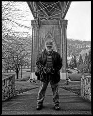 In J.H. Lartigue's Shadow 1602xx (jimhairphoto) Tags: camera bridge blackandwhite selfportrait blancoynegro film oregon america portland stjohns 4x5 hp5 pdx ilford rb naturalworld graflex blancinegre 1927 remainsoftheday blancetnoir portlandnw jimhairphoto schwarzeaufweis siyahrebeyaz 4x5project unhommageàlartigue