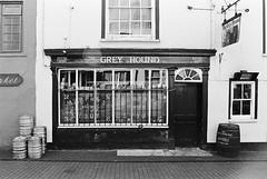 Kinsale 03 - The Grey Hound (Ian Atrus Gazzotti  iangazzotti.com) Tags: door ireland blackandwhite bw greyhound analog 35mm grey pub inn nikon barrels barrel hound bn kinsale biancoenero irlanda nikonf70 f70