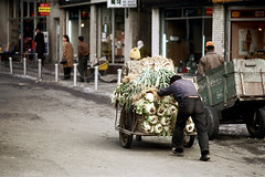 31-235 (ndpa / s. lundeen, archivist) Tags: street city winter people man color men fall film vegetables shop 35mm store candid nick citylife streetphotography streetlife korea sidewalk korean seoul storefront cabbage shops pedestrians push produce storefronts cart 1970s stores southkorea load 1972 31 pushing dewolf onfoot nickdewolf photographbynickdewolf reel31