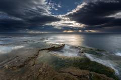 Escondido entre las nubes (Jose HL) Tags: sea espaa seascape valencia sunrise mar spain cabo mediterraneo paisaje alicante rocas cervera josehernandez cabocervera anamecer largaexposicindiurna