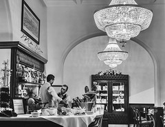 Fine Dining - Florence, Italy (mikederrico69) Tags: blackandwhite bw food bar dinner lights florence cafe italia room meeting bistro romance eat meal tables chandeliers romantic service dining supper restaurent waiters barman