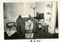 Boy in Salt Bag, 1949 (StevenM_61) Tags: boy bag child livingroom 1940s sack 1949