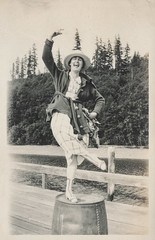 Woman dancing on top of a barrel (simpleinsomnia) Tags: old woman white black water monochrome vintage found blackwhite dock antique snapshot barrel off photograph goofingoff vernacular goofing foundphotograph
