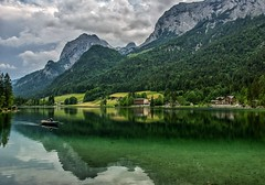 Haven't been out with my camera much lately. Most of my recreational time has been spent riding my bike the last few weeks, so here's another shot from last year in Germany. Pictured here is the Hintersee in Berchtesgaden (plottsdaniel) Tags: longexposure lake storm mountains alps clouds reflections germany landscape bavaria photography reflecting berchtesgaden landscapes boat nikon canoe reflect nikkor dslr hintersee ramsau landscapephotography bavarianalps berchtesgadenerland berchtesgadennationalpark feelthealps