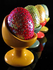 Shuffled Easter eggs (lady.bracknell) Tags: macro easter eggs sequins primarycolours eastereggs eggcups