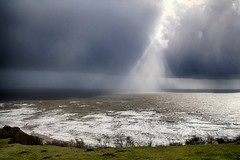 Rainbeam (OutdoorMonkey) Tags: ocean light sea sunlight storm sunshine rain weather squall coast seaside waves coastal dorset charmouth