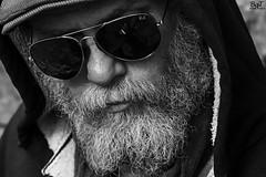 Beard man (Hombre con barba) (borjamuro) Tags: barcelona street portrait musician españa man texture textura sol sunglasses hair de beard calle spain nikon 7100 retrato espana gafas hombre barba pelo músico d7100