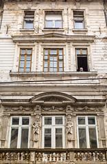 Aged (Brînzei) Tags: windows people ruins decay balcony rusty relief ornaments m42 pensive junkyard manualfocus artifacts ★ cavemanart bucurești centrulvechi carlzeissjenaflektogon35mmf24mc jenaddr pentaxk30