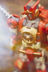 Come here, Kaon (MMortAH) Tags: red macro toy toys robot nikon bokeh vinyl plastic transformers micro 28 40mm division nikkor mmc decepticon 3p morethanmeetstheeye kaon justic electricchair d90 djd anarchus mtmte mastermindcreations anachus