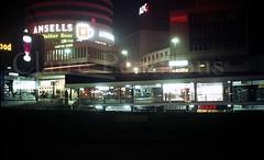 Birmingham Bull Ring Shopping centre & Rotunda, c1968 (Lady Wulfrun) Tags: beer shop night ads birmingham nightshot streetlights ad hamilton illuminated advert shops 1960s 1968 bullring lloydsbank shopfronts ansells stmartinscircus hrowley meesonn