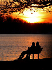 Sharing A Winter Sunset   -  HBM! (jrussell.1916) Tags: winter orange yellow reflections lakes silhouettes sunsets benches shawneemissionpark canonef70200mmf4lis