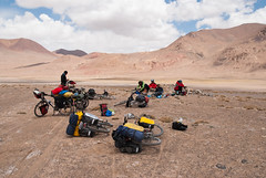 Short break on warm rock :] (Michal Pawelczyk) Tags: trip holiday mountains bike bicycle june cyclists nikon asia flickr aim centralasia pamir gosia gory wakacje 2015 czerwiec azja d80 pamirhighway gbao azjasrodkowa azjacentralna