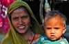 India-Gujarat-Chandrana village-Adiwasi people (venturidonatella) Tags: portrait people woman india colors nikon women asia faces gente persone colori ritratto gentes madre gujarat volti facce bambino d300 minorities volto adivasi minoranza adiwasi nikond300 chandrana