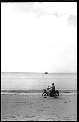 on the beach (Bo N) Tags: bw water photoshop thailand boat d76 halfframe 100asa 2015 fujicahalf kentmere100