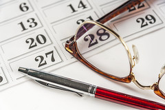 Pen And  Eyeglasses On The Calendar (AudioClassic) Tags: brown macro classic sign closeup pen writing day calendar object literature number business whitebackground document backgrounds remote date eyeglasses important searching closeto threeobjects personalaccessory onwhitebackground officeinterior goldcolored