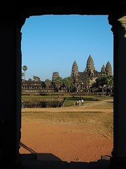 man-made wonder (SM Tham) Tags: trees sky people building monument water stone architecture palms temple pond cambodia khmer library buddhist towers columns angkorwat unescoworldheritagesite frame angkor grounds lotusbud suryavarmanii
