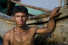 Nur Majhi (Minhaz Nizami) Tags: poverty travel sea portrait people work photography boat fisherman photojournalism documentary lifestyle health labour humanrights bangladesh climate boatman travelphotography workingpeople workersright
