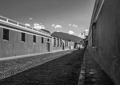 Perspectiva de Antigua (Jos M. Hosttas) Tags: street windows mountain architecture clouds landscape calle arquitectura cityscape colonial paisaje ventanas nubes moto motorcycle montaa sidewalks paved empedrado antiguaguatemala aceras