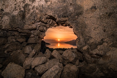 Sunset through the fortress 4-3 BC in Porto Germeno. (Vagelis Pikoulas) Tags: sunset sun castle rock stone canon landscape spring rocks europe view tokina greece porto april 6d 2016 germeno 1628mm