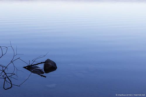 Stone in lake.